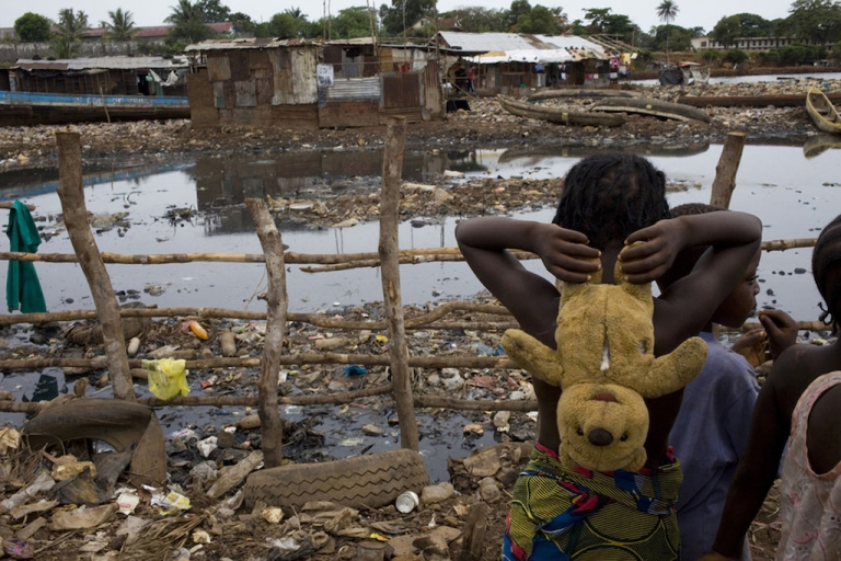 <p>Children play silently as danger lurks in the waters in the slums of Kroo Bay on May 3, 2010 in Freetown, Sierra Leone. Diarrhea kills more young children each year than HIV/AIDS, tuberculosis and malaria combined around the world.</p>