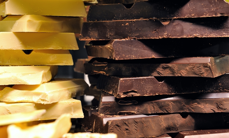 <p>White and black chocolate bars are displayed at a stand as part of the 'Salon du Chocolat' (chocolate fair) on March 9, 2012, in Lille.</p>