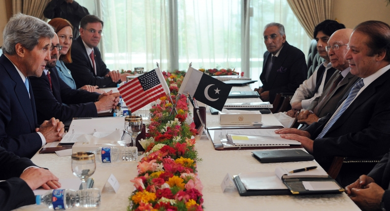 <p>Pakistani Prime Minister Nawaz Sharif (R) holds talks with US Secretary of State John Kerry (L) during their meeting at the Prime Minister's House in Islamabad. Sharif is due to meet with President Barack Obama at the White House on October 23, 2013.</p>
