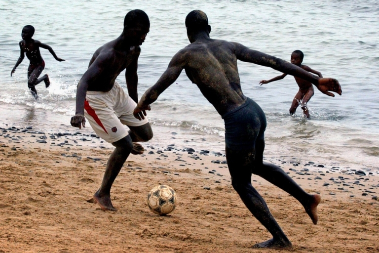 <p>Middle-aged European women go to Senegal's beaches to find romance with young men like these two who are playing beach football in the capital Dakar, May 24, 2005.</p>