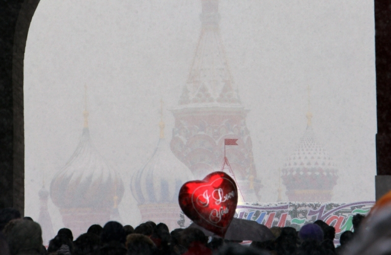 <p>People carry a heart-shaped balloon as they celebrate Valentine's Day in central Moscow on Feb. 14, 2009. Grigory Sobchenko</p>