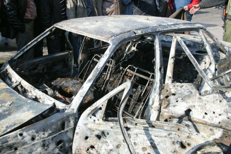 <p>An image published by state news agency SANA shows one of the two cars reportedly packed with explosives and set off outside government buildings in Damascus, Dec. 23, 2011.</p>