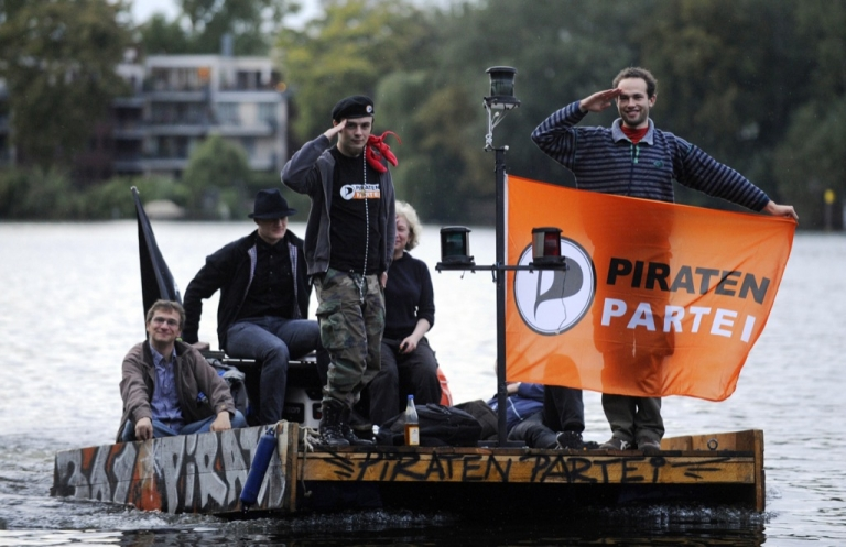 <p>Members of the German Pirate Party sail on the River Spree during a