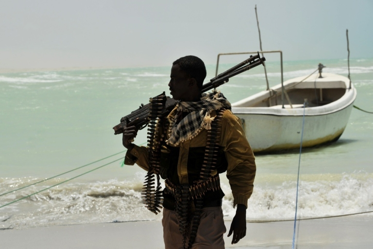 <p>Somali pirates in the Indian Ocean are becoming more aggressive and more deadly. A Somali pirate carries his high-caliber weapon on a beach in the central Somali town of Hobyo on August 20, 2010.</p>