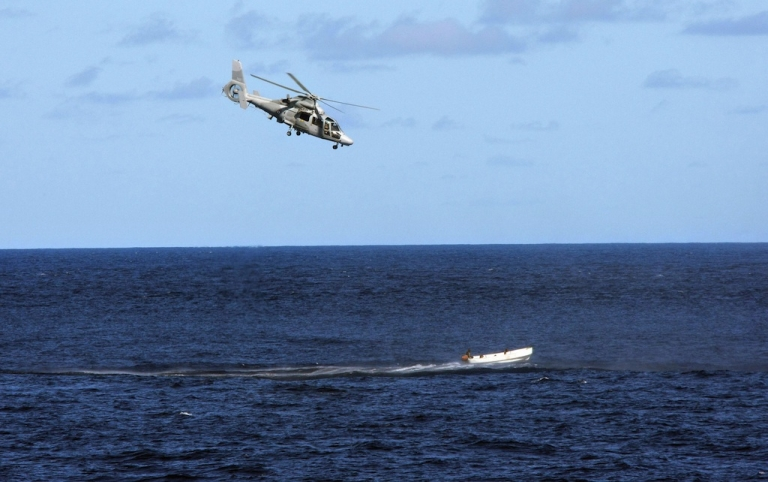 <p>A French Navy helicopter chases a boat carrying suspected Somali pirates off the French warship Le Nivose on May 3, 2009.</p>