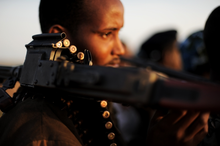 <p>An armed fighter allied to the Somalia's Hobyo pirates holds his high caliber weapon near the central Somali town of Galkayo on Aug. 18, 2010. Hobyo pirates have collected millions of dollars in ransoms over the past two years. They even have currency checking and counting machines for the bags of air-dropped cash they receive.</p>