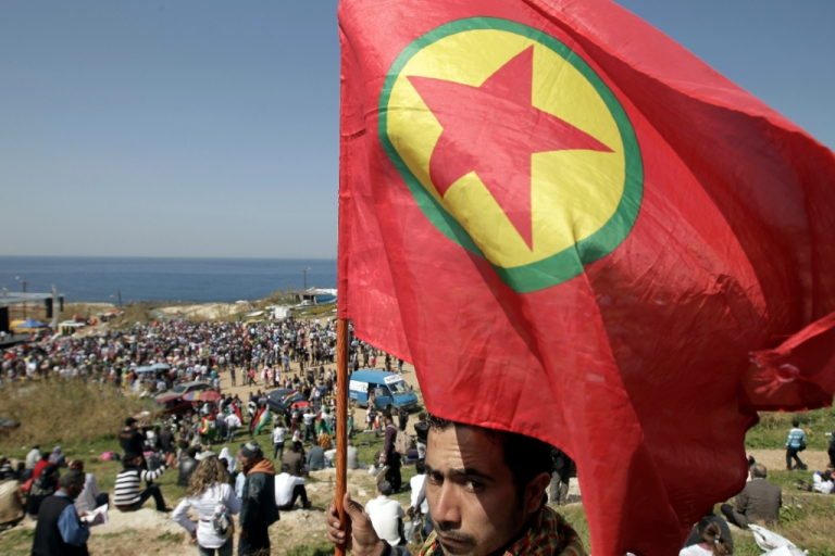 <p>A Kurdish man holds up a flag of the Kurdistan Workers Party (PKK) during Noruz spring festival in the Lebanese capital Beirut on March 21, 2012.</p>
