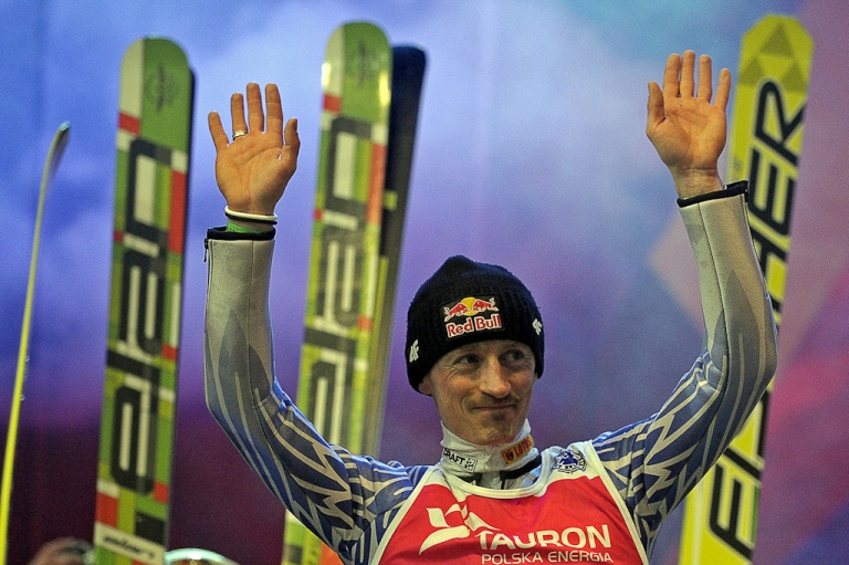<p>Polish ski jumper Adam Malysz greets fans during his farewell event in Zakopane, Poland on March 26, 2011. Malysz braved a heavy snowfall, refusing to skip his chance to bow out in the air in his homeland, where he is a sporting icon, despite the poor conditions.</p>