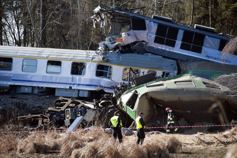 <p>Policemen stand by the wreckage of two trains near the town of Szczekociny in southern Poland. The cause of the crash has yet to be determined.</p>