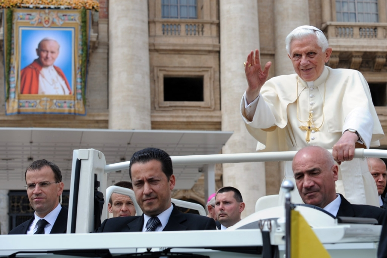 <p>Pope Benedict XVI waves as he stands with butler Paolo Gabriele, center, on May 4, 2011, at St Peter's square at The Vatican.</p>