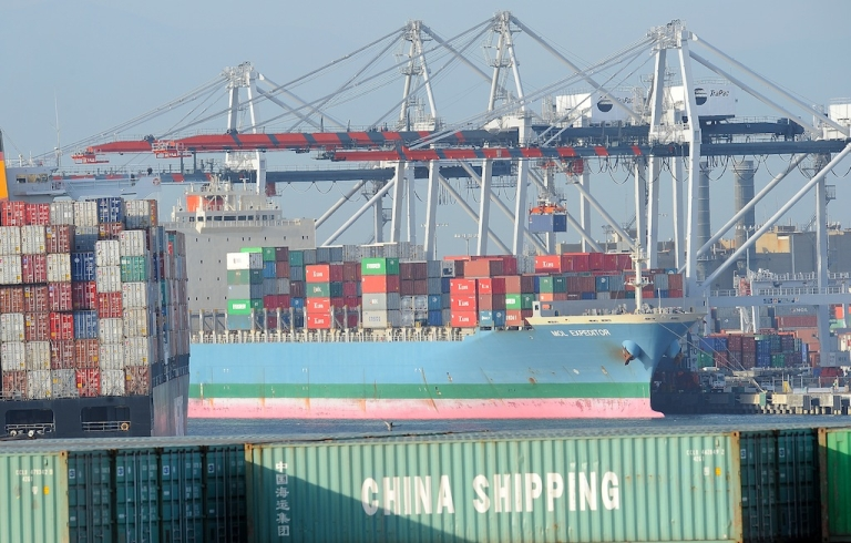 <p>A container is off loaded from a ship at the Port of Los Angeles in San Pedro, California on May 12, 2010. A worker strike has shut the ports of Los Angeles and Long Beach for four days.</p>