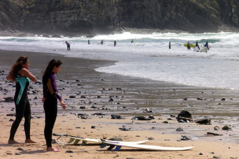 <p>Surfers prepare to hit the waves at Arrifana beach in southwestern Portugal on April 22, 2011.</p>