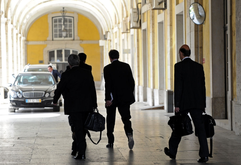 <p>Representatives of the International Monetary Fund, the European Union and the European Central Bank leave a meeting with Portuguese Finance Minister Fernando Teixeira dos Santos at the Finance Ministry in Lisbon on April 18, 2011.</p>