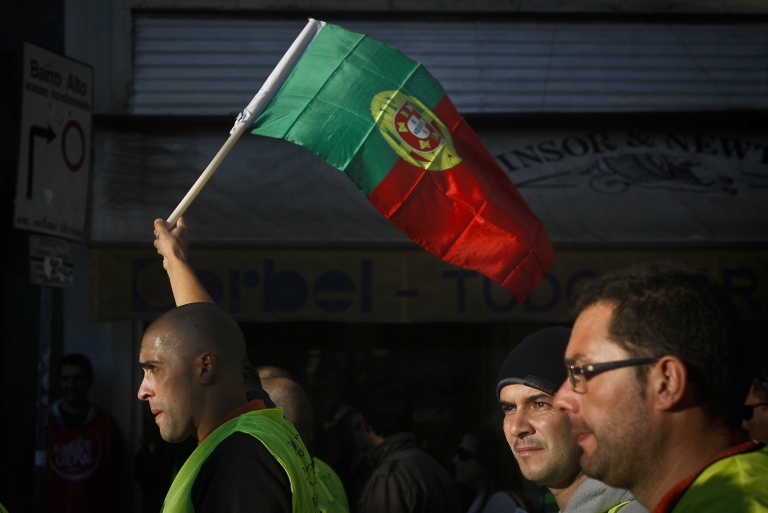 <p>Portuguese workers protest during government austerity measures.</p>