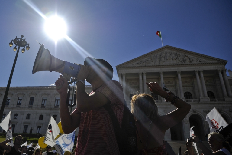 <p>Teachers protest budget cuts outside parliament in Lisbon. Others are leaving.</p>