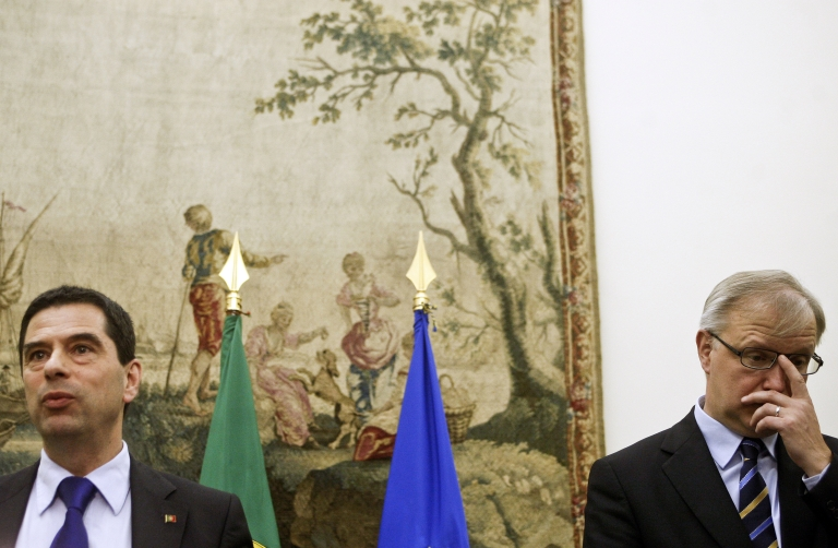 <p>European Commissioner for Economic and Financial Affairs Olli Rehn (R) attends a press conference accompanied by the Portuguese finance minister, Vitor Gaspar (L) at S. Bento Palace, in Lisbon, on March 14, 2012.  Portugal is swallowing the EU's austerity medicine in return for loans.  It seems that medicine is not helping individual patients using the country's health system.</p>