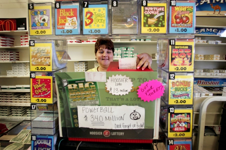<p>Maryanne Rearick rings up Powerball lottery tickets for customers at a cigarette store in Whiting, Indiana.</p>