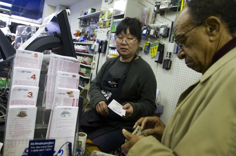 <p>Morris James of Washington, DC, buys Powerball tickets for Wednesday's draw.</p>