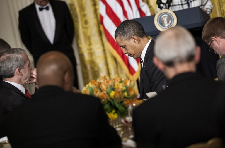 <p>US President Barack Obama bows his head with others in prayer during a prayer breakfast in the East Room of the White House April 4, 2012 in Washington, DC. Obama proclaimed today the 61st National Day of Prayer.</p>