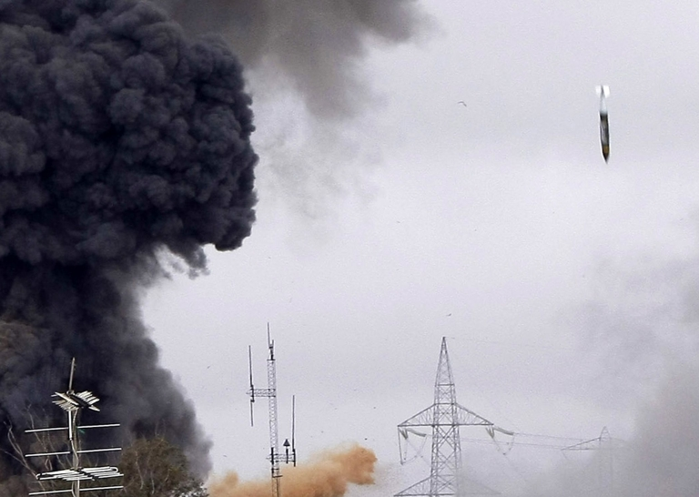<p>A missile drops on the tightly-guarded residence of leader Muammar Gaddafi and military targets in the Tripoli suburb of Tajura. NATO-led coalition aircraft had been seen in the skies over the capital earlier in the afternoon.</p>
