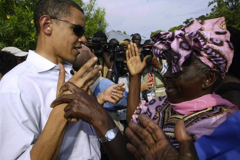 <p>Then-US Senator Barack Obama greets his grandmother Sarah Obama at their rural home in Siaya, Kisumu, on Aug. 26, 2006 during his first visit in 14 years.</p>