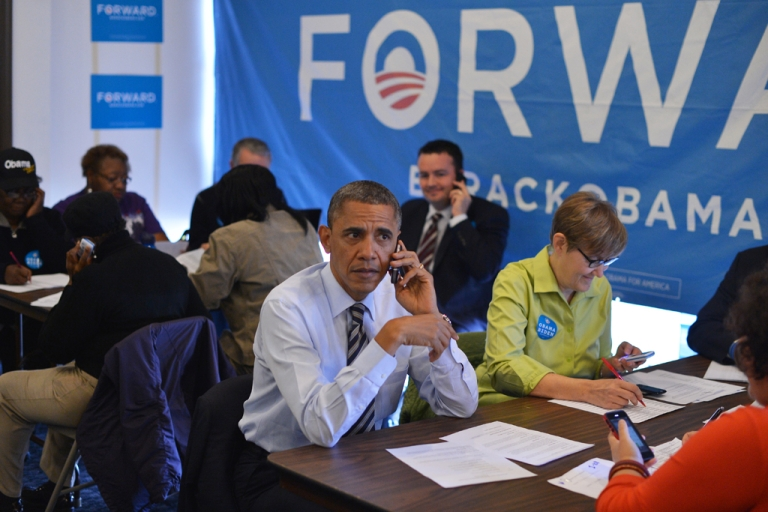 <p>US President Barack Obama calls a volunteer from a campaign office in Chicago, Illinois, on election day, November 6, 2012.</p>