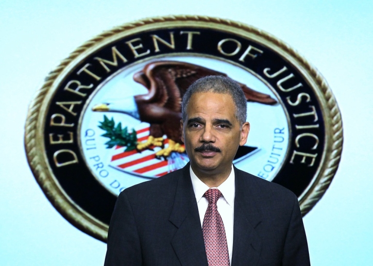 <p>U.S. Attorney General Eric Holder speaks during an event November 29, 2011, at the South Court Auditorium of the Eisenhower Executive Office Building of the White House in Washington, DC.</p>