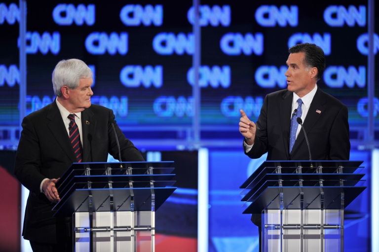 <p>Republican presidential candidates, former House Speaker Newt Gingrich (L) listens to former Massachusetts governor Mitt Romney (R) during the Florida Republican Presidential debate January 26, 2012</p>