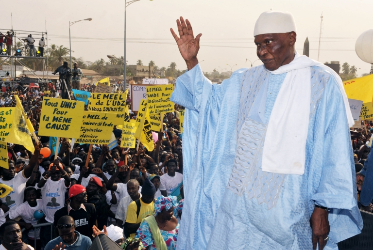 <p>Senegal's President Abdoulaye Wade (R) waves to his supporters during a rally in the capital of the Casamance region Ziguinchor on February 11, 2012, ahead of February 26 presidential election.</p>