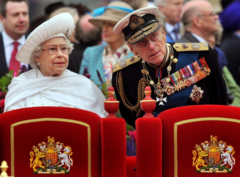 <p>Picture taken on June 3, 2012 shows Britain's Queen Elizabeth (L) and Prince Philip, Duke of Edinburgh, standing onboard the Spirit of Chartwell during the Thames Diamond Jubilee Pageant on the River Thames in London.</p>