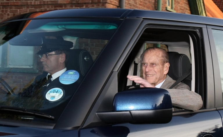 <p>Prince Philip waves as he is driven away from Papworth Hospital in Cambridge, England, on Dec. 27, 2011.</p>