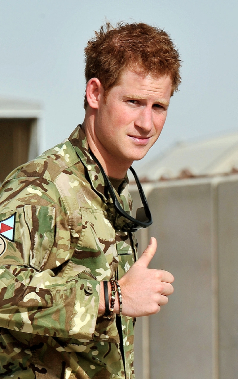 <p>Britain's Prince Harry gives the thumbs up upon his arrival at Camp Bastion in Afghanistan, on September 7, 2012. Britain's Prince Harry is back in Afghanistan to serve as a military helicopter pilot four years after his previous deployment there had to be cut short, the Ministry of Defence said on Friday.</p>