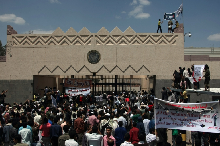 <p>Yemeni protesters try to break through the gate of the US embassy in Sanaa during a protest over a film mocking Islam on September 13, 2012. Yemeni forces managed to drive out angry protesters who stormed the embassy in the Yemeni capital with police firing warning shots to disperse thousands of people as they approached the main gate of the mission.</p>
