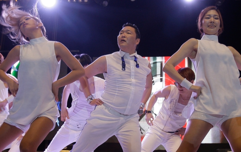 <p>Psy performs onstage at Kyonggi University in Suwon, South Korea, on September 25, 2012.</p>