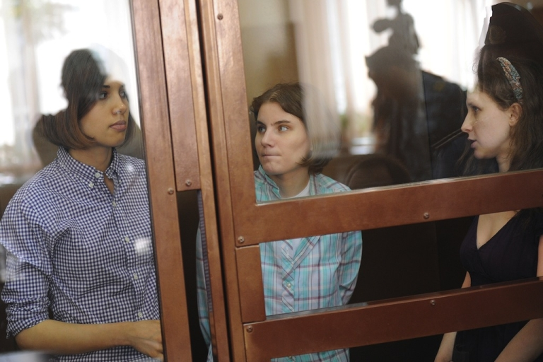 <p>Members of the all-girl punk band 'Pussy Riot.' Nadezhda Tolokonnikova (L), Maria Alyokhina (R) and Yekaterina Samutsevich (C), sit during a court hearing in Moscow on July 30, 2012. In February, five women walked silently into Moscow's Church of Christ the Saviour before clambering over railings, pulling on balaclavas, and singing out a protest song against Vladimir Putin. The three have already spent four months in jail awaiting trial .</p>