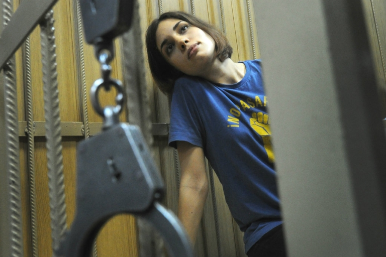 <p>Nadezhda Tolokonnikova, a member of female Russian punk band Pussy Riot, sits inside a defendants cage in a Moscow court during the hearings on the Pussy Riot case.</p>