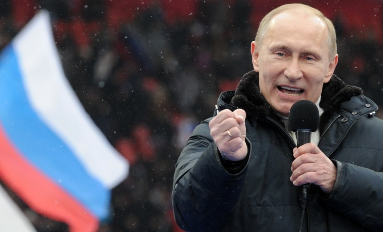 <p>Putin, drumming up support at a recent rally.</p>