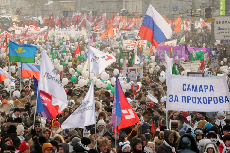 <p>Pollsters predict Prime Minister Vladimir Putin will win the first round of the March 4 election for the presidency with more than half the vote, even as the opposition continues to hold rallies in protest. In this picture, from February 4, 2012, people rallied in central Moscow to urge Putin to quit power. One of the posters reads: