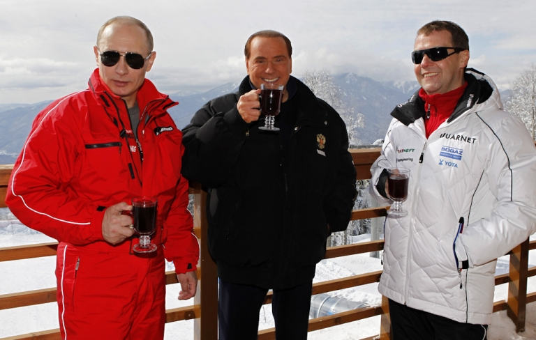 <p>Russia's outgoing President Dmitry Medvedev (R) and newly elected president Vladimir Putin (L) meet with former Italy's Prime minister Silvio Berlusconi at the Rosa Khutor apline ski resort in Krasnaya Polyana, some 30 miles from Sochi, on March 8, 2012. Italy's ex-prime minister Silvio Berlusconi flew into Russia for a lavish dinner with Vladimir Putin after his old ally's victory in presidential elections, state television said.</p>