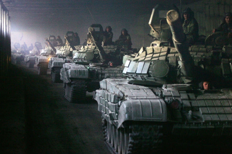 <p>A column of Russian armoured vehicles moves towards the Roki tunnel on the border with Russia as they leave South Ossetia on August 23, 2008.</p>
