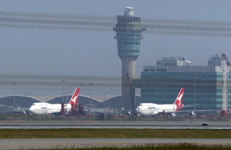 <p>Qantas aircraft sit parked on the tarmac at Hong Kong's international airport on October 30, 2011. Australian flag carrier Qantas on October 29 took the drastic step of grounding its entire fleet indefinitely in an escalating industrial dispute that sparked travel chaos for passengers around the world.</p>