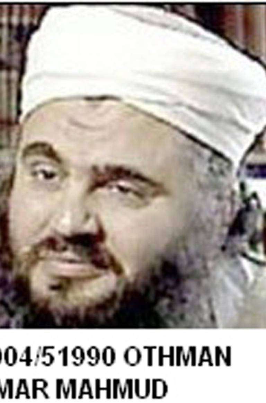 <p>Omar Mahmud Othman, alias Abu Qatada, passport number 405914D, appears in this undated photograph accompanying his Interpol bulletin.</p>