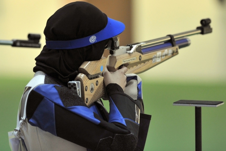 <p>Kuwaiti Ayat al-Duwaikhi competes in the women's air rifle competition at the Lusail Shooting Complex in Doha during the 2011 Arab Games in Qatar on December 11, 2011.</p>