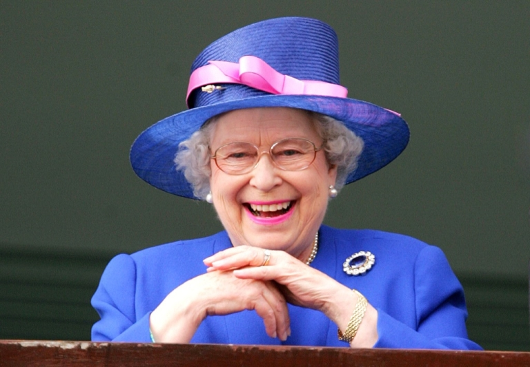<p>Queen Elizabeth II watches as Jockey Frankie Detorri crosses the finish line to win the Vodafone Derby with Irish horse Authorized on the second day of the annual Vodafone Derby horse race at Epsom Downs, Surrey, on June 2, 2007.</p>