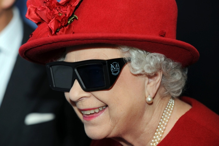 <p>Queen Elizabeth II wears 3 D glasses to watch a display and pilot a JCB digger, during a visit to the University of Sheffield Advanced Manufacturing Research centre, on November 18, 2010 in Sheffield, England.</p>
