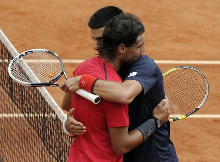 <p>Rafael Nadal (L) hugs Novak Djokovic, who he beat in four sets to win the 2012 French Open.</p>