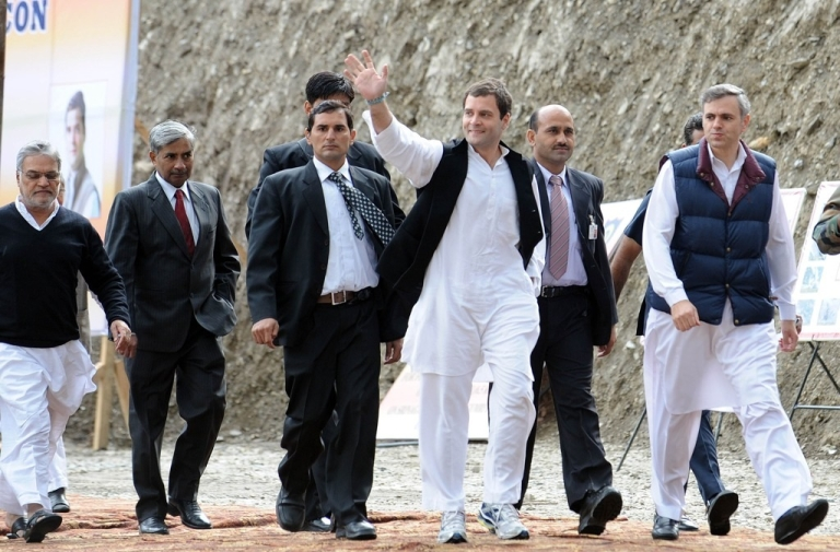 <p>Rahul Gandhi waves as he arrives at Sonamarg, India on Oct. 4,2012.</p>