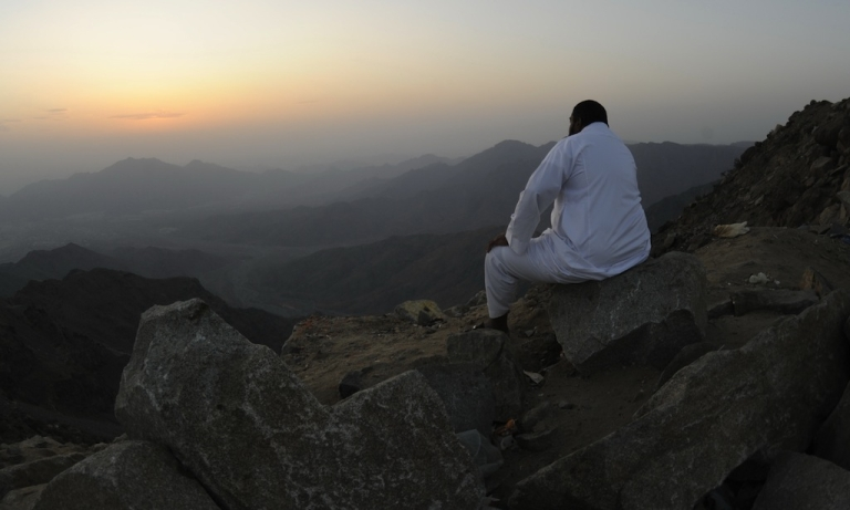<p>A man sits on the side of a hill waiting to see the new moon of Ramadan as astronomers and scholars of Islam debate when the holy Muslim month of Ramadan begins, in the Saudi city of Taif on July 19, 2012. The start of the fasting month, when the faithful abstain from eating from dawn to sunset, is determined by the sighting of the new moon.</p>