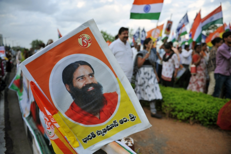 <p>Members of Mahila Patanjali Yog Samithi and Bharath Swabhiman trust participate in a rally  in support of Indian spiritual guru Baba Ramdev's hunger strike in Hyderabad on June 11, 2011. An Indian yoga guru holding a hunger strike against corruption was hospitalised June 10 after not eating for nearly a week in a protest that has put pressure on the government. Swami Ramdev, whose popularity stems from his daily TV yoga shows, had continued fasting at his ashram near the holy city of Haridwar after baton-wielding police broke up his protest in New Delhi.</p>