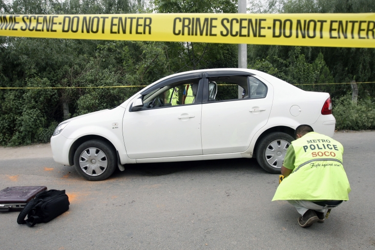 <p>Nepalese crime officers examine the car in which Supreme Court Judge Rana Bahadur Bam was shot dead in Kathmandu on May 31, 2012.</p>